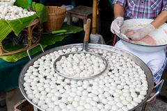 Meat or rice balls frying in oil at street market Stock Photo