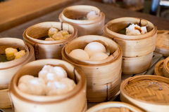 Meat or rice balls in wooden containers Stock Photo