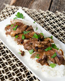 Meat and Rice Dinner Food. A plated dish of meat and rice Stock Photo