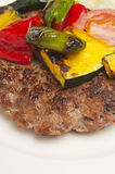Meat rissole with vegetables. On a plate for lunch Stock Photo