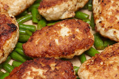 Meat rissoles or cutlets in frying pan, cooking process Stock Photos