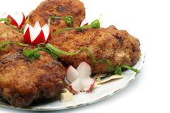 Meat rissoles with garden radish Royalty Free Stock Image