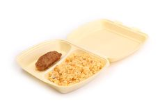 Meat rissoles with rice in food container. On a white background Stock Image