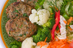 Meat rissoles with vegetables Stock Photo