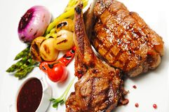 Meat roasted with vegetable. Various types meat roasted with vegetable closeup Beef roasted potato and vegetables Lamb chops with garnish carved roast beef and stock image