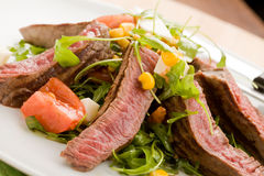 Meat with Rocket salad Royalty Free Stock Image