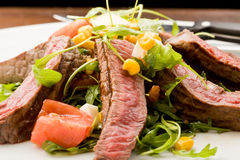 Meat with Rocket salad Royalty Free Stock Photo