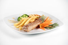 Meat role served with vegetables on a plate Royalty Free Stock Images