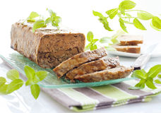 Meat roll with basil leaves Royalty Free Stock Photo