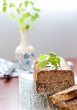Meat roll with basil leaves Stock Photos