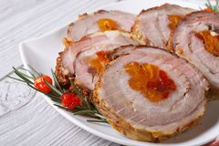 Meat roll with dried apricots and cherries closeup Stock Photos