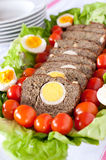 Meat roll. With eggs, fresh salad and cherry tomatoes Stock Images