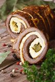 Meat roll stuffed with eggs and cucumber closeup. vertical Royalty Free Stock Image
