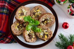 Meat roll stuffed with eggs, olives, sundried tomatos. royalty free stock photography