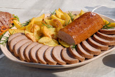 Meat rolle with french freis Stock Photos