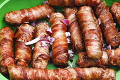 Meat rolled with bacon Royalty Free Stock Images