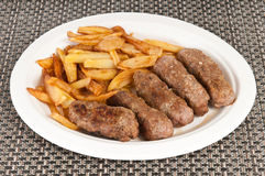 Meat rolls. Grilled romanian meat rolls with potatoes Royalty Free Stock Photos