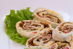 Meat rolls with green salad on a plate. Meet with cheese rolls on the plate Royalty Free Stock Photos