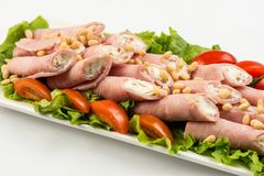 Meat rolls with ham, cheese and greens, on white background royalty free stock images