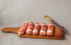 Meat rolls and knife Royalty Free Stock Images