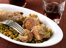 Meat rolls with peas. On dish royalty free stock photography
