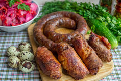 Meat rolls and pork sausage Stock Images