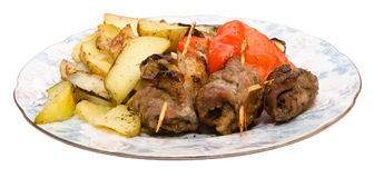 Meat rolls with potatoes. Rolls of meat with vegetables and baked potatoes Royalty Free Stock Images