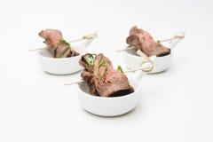 Meat rolls on skewers. Various snacks Stock Image