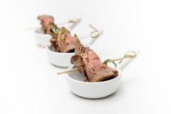 Meat rolls on skewers. Various snacks Stock Photos