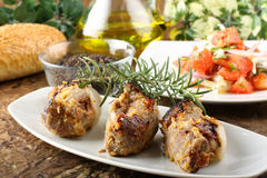 Meat rolls stuffed. On complex background Stock Image