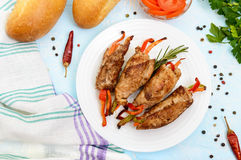 Meat rolls stuffed with sweet pepper, carrots on a light background. Royalty Free Stock Photography