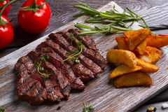 Meat and rosemary. Stock Photography