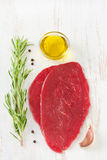 Meat with rosemary, pepper, oil royalty free stock photography