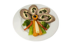 Meat roulade. Meat loaf with spinach and vegetables Stock Images