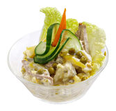 Meat Salad. With some greens on it in a glass bowl on white isolated background Royalty Free Stock Image