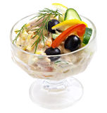 Meat Salad. With some greens and olives on it in a glass bowl on white isolated background Stock Photo