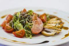 Meat salad for banquet. Meat salad greens with tomatoes Royalty Free Stock Photo