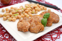 Meat with a salad of chick peas Stock Photos