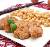 Meat with a salad of chick peas Stock Photo