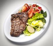 Meat and salad. Delicious meat dish with salads royalty free stock image