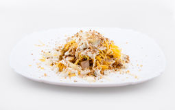 Meat salad with eggs and walnuts. On a white plate Stock Photography