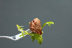 Meat and salad on a fork Royalty Free Stock Image