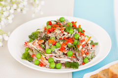 Meat salad with fresh green peas Stock Image
