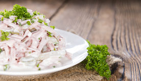 Meat salad (with mayonnaise) on a plate Royalty Free Stock Image