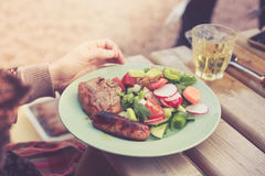 Meat and salad outdors on table Stock Photo