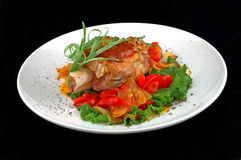 Meat with salad pepper. And tomatoes on a black background stock images