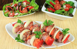 Meat and salads Royalty Free Stock Images