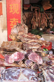 Meat for sale in a traditional market of Kunming in China. Kunming, China - January 9, 2016: Meat for sale in a traditional market of Kunming in China Stock Image