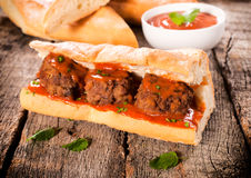 Meat sandwich. Bread stuffed with meat balls and tomato sauce Royalty Free Stock Photography