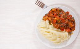 Meat in sauce with mashed potatoes Royalty Free Stock Photo
